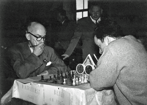 Dublin Zonal: IM William Fairhurst, SCO, left, GM Pal Benko, HUN (later USA), right, and with hand on chair, IM Arthur Dunkelblum, BEL (photo Joe Keenan)